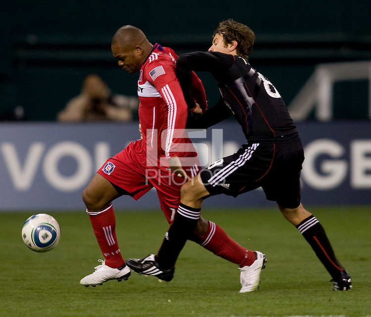 Collins John (15) of the Chicago Fire is fouled from behind by Carey Talley (8) of DC United at RFK Stadium in Washington, DC.  The Chicago Fire defeated DC United, 2-0.