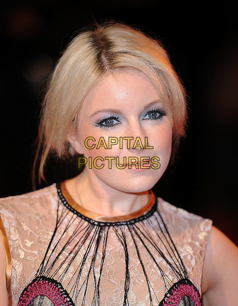 VICTORIA HESKETH aka LITTLE BOOTS.The Royal Film premiere of 'The Lovely Bones' at the Odeon, Leicester Square, London, England. .November 24th 2009 .headshot portrait black cream white lace layered layers red sleeveless stitching sleeveless hair up gold make-up eyeliner .CAP/BEL.©Tom Belcher/Capital Pictures.