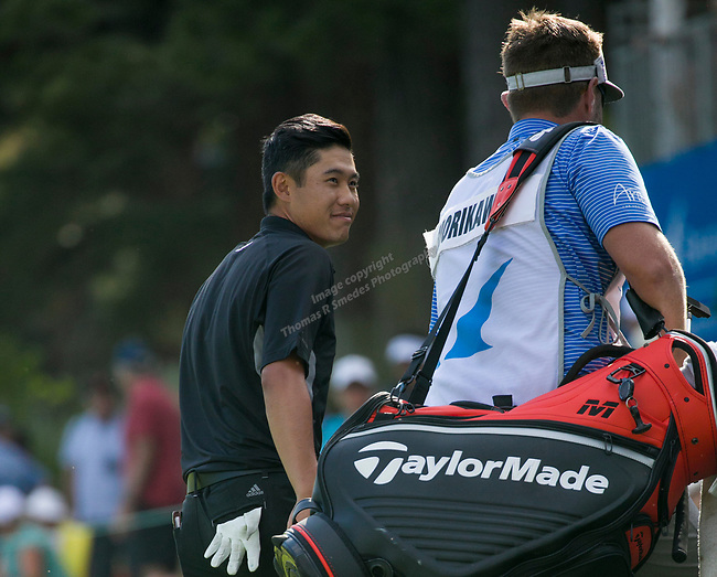 Collin Morikawa smiles at his caddy afterwinning the Barracuda Championship PGA golf tournament at Montrêux Golf and Country Club in Reno, Nevada on Sunday, July 28, 2019.