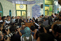 Mir-Hossein Mousavi, opposition candidate in the 2009 presidential election, speaks to the media after casting his vote at Ershad mosque. He is accompanied by his wife Zahra Rahnavard, a writer, artist and political scientist.