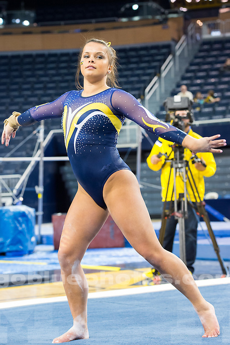 The University of Michigan women's gymnastics team; 196.150 - 192.400,victory over EMU at Crisler Arena in Ann Arbor, Mich., on Dec.07, 2014.