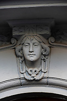 Architectural detail of a woman's head on a building facade. Alesund, Norway. The town is famous for its art nouveau (Jugendstil) architecture.