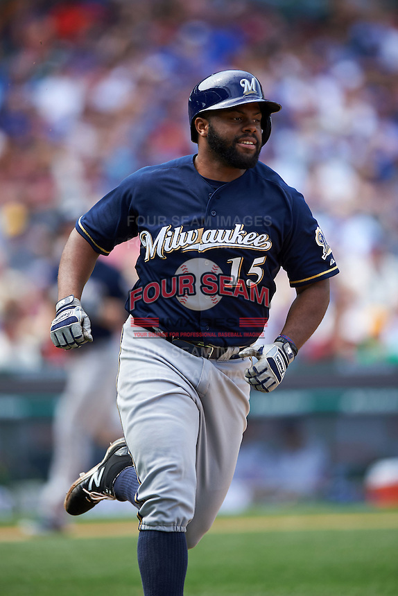 Milwaukee Brewers outfielder Jason Rogers (15) runs to first during a game against the Chicago Cubs on August 13, 2015 at Wrigley Field in Chicago, Illinois.  Chicago defeated Milwaukee 9-2.  (Mike Janes/Four Seam Images)