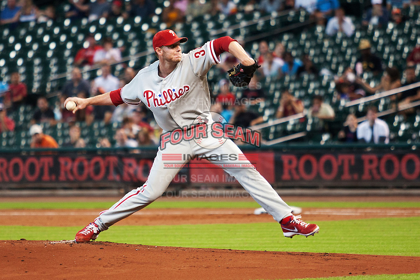Philadelphia Phillies pitcher Roy Halladay #34 delivers during the Major League baseball game against the Houston Astros on September 16th, 2012 at Minute Maid Park in Houston, Texas. The Astros defeated the Phillies 7-6. (Andrew Woolley/Four Seam Images).