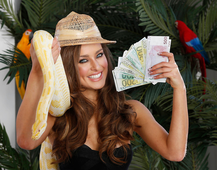 EuroMillions jackpot a scintillating ?70 million!.Rozanna Purcell is draped in a charming snake promoting the Euromillions jackpot draw. ..- ends -.. ..For further information please contact:.. .Eleanor Murphy (National Lottery) eleanor.murphy@lottery.ie 087 9884358..Martyn Rosney (WHPR) martyn.rosney@ogilvy.com  085 728 2151  .