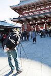 A foreign tourist poses for a photograph at Sensoji temple in Asakusa district on January 22, 2016, Tokyo, Japan. The Japan National Tourism Organization reported on Tuesday 19th a record increase in foreign visitors in 2015. Approximately 19.73 million people visited Japan from abroad, up 47.3 percent. According to the report there were more Chinese visitors than from any other nation with 4.99 million coming in 2015. South Korea (4 million) and Taiwan (3.67 million) were next on the list, and over 1 million Americans also visited Japan in 2015. The number of visitors is the highest in 45 years and already close to Japan's goal of attracting 20 million foreign visitors in a year by 2020. (Photo by Rodrigo Reyes Marin/AFLO)