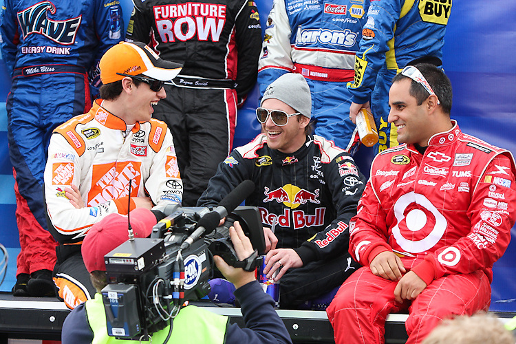 (from l-r): Joey Logano, Brian Vickers, and Juan Pablo Montoya relax before the start of their Sprint Cup race at Auto Club Speedway in Fontana, CA.