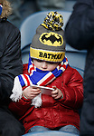 A young Rangers fan checking the other scores at half-time