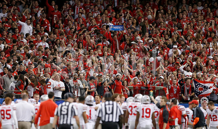 Fans react to the interception for a touchdown by Ohio State Buckeyes defensive lineman Steve Miller (88) during the third quarter in the Allstate Sugar Bowl college football playoff semifinal at Mercedes-Benz Superdome in New Orleans on Thursday, January 1, 2015. (Columbus Dispatch photo by Jonathan Quilter)