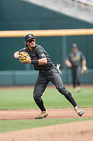 Vanderbilt Commodores third baseman Austin Martin (16) makes a throw to first base during Game 8 of the NCAA College World Series against the Mississippi State Bulldogs on June 19, 2019 at TD Ameritrade Park in Omaha, Nebraska. Vanderbilt defeated Mississippi State 6-3. (Andrew Woolley/Four Seam Images)
