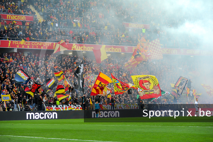 20191221 - LENS , FRANCE :  illustration picture shows the supporters in the Trannin tribune pictured during the soccer match between Racing Club de LENS and Niort , on the 19 th matchday in the French Ligue 2 at the Stade Bollaert Delelis stadium , Lens . Saturday 21 December 2019. PHOTO STIJN AUDOOREN | SPORTPIX.BE
