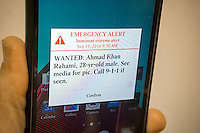 A CMAS text alert on a smartphone warns the user that the police are looking for Ahmad Khan Rahami, a suspect in the  recent bombings in New York and New Jersey, seen on Monday, September 19, 2016.   (© Richard B. Levine)