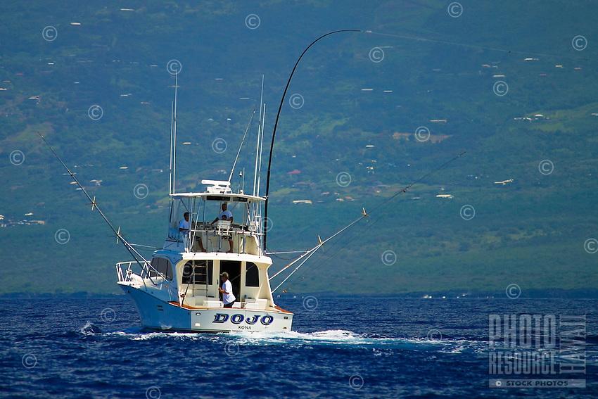 Sport fishing boat with Hawaiian Green Stick tuna rig, Kona Coast, Big Island.