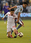 Pablo Barrientos of Toluca (left) and Roger Espinoza of Sporting KC vie for the ball during their CONCACAF Champions League game on February 21, 2019 at Children's Mercy Park in Kansas City, KS.<br /> Tim VIZER/Agence France-Presse