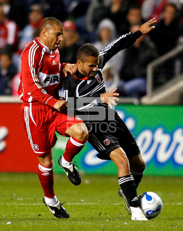 Chicago Fire midfielder Chris Armas (14) pressures DC United midfielder Fred (7). The Chicago Fire defeated D. C. United 1-0 during the first leg of the MLS Eastern Conference Semifinal Series at Toyota Park in Bridgeview, IL, on October 25, 2007.