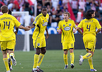 Columbus Crew's Andy Iro is congratulated by teammates after scoring a goal. Chivas USA defeated the Columbus Crew 2-1at Home Depot Center stadium in Carson, California on Sunday April 5, 2009.  .Photo by Michael Janosz/ isiphotos.com
