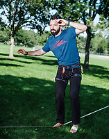Working with experts at Rocky Mountain Slackline, Adventure columnist, Clint Carter practices slacklining at Spring Park in Ft. Collins, Colorado, Sunday, August 27, 2017. Carter take on a vertigo-inducing highline that stretches across a traverse after only 4 days of training.<br /> <br /> Photo by Matt Nager