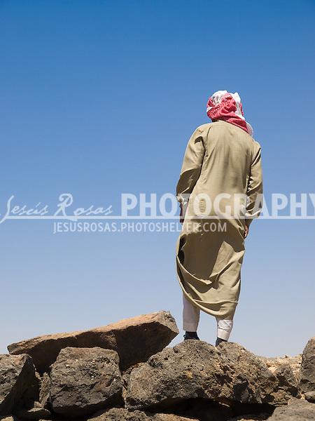 Bedouin Arab in Jordan wearing the traditional keffiyeh and jellabiya