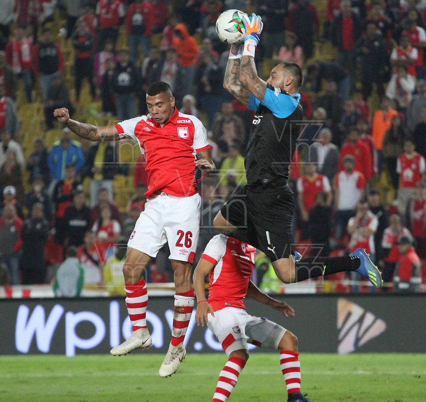 BOGOTÁ- COLOMBIA, 13-04-2019:Diego Novoa (Der.)  guardameta de La Equidad  disputa el balón con Camilo Charria (Izq.) Jugador del Independiente Santa Fe durante  partido por la fecha 15 de La Liga Aguila I 2019 ,jugado en el estadio Nemesio Camacho El Campin de la ciudad de Bogotá. / Diego Novoa (R) goalkeeper of La Equidad fights the ball agaisnt of Independiente Santa Fe during match for the date 15 as part Aguila League I 2019 between Independiente Santa Fe  and La Equidad   played at Nemesio Camacho el Campin  stadium in Bogota city.  Photo: VizzorImage / Felipe Caicedo / Staff