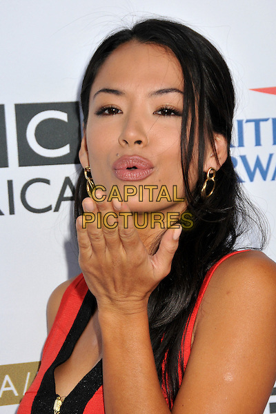STEPHANIE JACOBSEN.7th Annual BAFTA TV Tea Party held at the Intercontinental Hotel, Century City, California, USA..September 19th, 2009.headshot portrait black red gold earrings hand blowing kiss  .CAP/ADM/BP.©Byron Purvis/AdMedia/Capital Pictures.