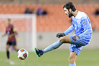 Houston, TX - Friday December 9, 2016: Walker Hume (37) of the North Carolina Tar Heels clears the ball from his side of the field against the Stanford Cardinal at the NCAA Men's Soccer Semifinals at BBVA Compass Stadium in Houston Texas.
