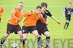 Tralee Dynamos Adam Pigott and Park's Jack Savage in action in the division 1A clash at Cahermoneen, Tralee on Sunday.