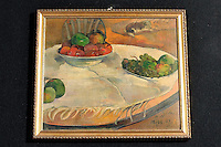 Paul Gauguin (Frutta su un tavolo o natura morta o piccolo cagnolino)<br /> Paul Gauguin's &quot;Fruits sur une table ou nature au petit chen, Fruits on the table, or still life, or little dog&quot; <br /> <br /> Roma 02-04-2014 Sede del MIBAC, Ministero per i Beni e le Attivita' Culturali. Presentazione alla stampa in occasione del ritrovamento di due quadri attribuiti a Paul Gaugain (Frutta su un tavolo o natura morta o piccolo cagnolino) ed a Pierre Bonnard (Fanciulla seduta in giardino), scomparsi n circostanze diverse gli anni '60 e comprati ad un asta delle Ferrovie dello Stato da un operaio per la modesta cifra di &pound; 45.000. <br /> Press conference to present two paintings recovered after they were stolen during the '60s. The two paintings, Paul Gaugain's &quot;Fruits sur une table ou nature au petit chen, Fruits on the table, or still life, or little dog&quot; and Pierre Bonnard &quot;La femme aux deux flauteuils, Girl in a garden&quot; were bought by a man at a auction of the italian Railway Company on 1975 for 45.000 liras (23 Euros). <br /> Photo Samantha Zucchi Insidefoto