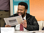 WATERBURY , CT-011619JS15- Mohammed Hassan with ION Savings Bank, reads a copt of the Republican-American newspaper during leadership classes for members of the Waterbury Regional Chamber and the Northwest Connecticut Chamber of Commerce held Wednesday at the Republican-American building in Waterbury. <br /> Jim Shannon Republican American
