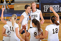 24 September 2010:  FIU's Ines Medved (11), Andrea Lakovic (1), Una Trkulja (7), Natalia Valentin (9) and Sabrina Gonzalez (12) celebrate winning a point in the first set as the FIU Golden Panthers defeated the University of Denver Pioneers, 3-0 (29-27, 25-16, 25-20), at U.S Century Bank Arena in Miami, Florida.