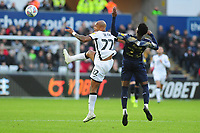 Andre Ayew of Swansea City vies for possession with Dani Pinillos of Barnsley during the Sky Bet Championship match between Swansea City and Barnsley at the Liberty Stadium in Swansea, Wales, UK. Sunday 29 December 2019