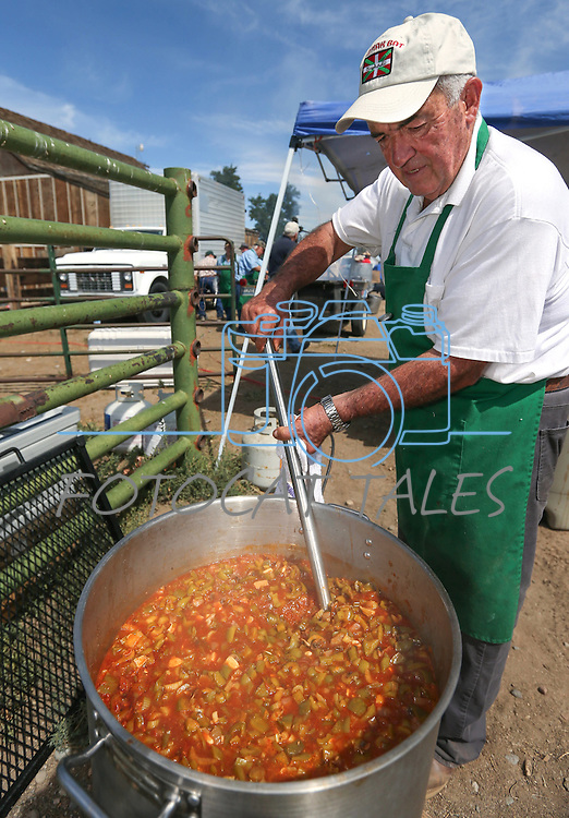 Jesus Rey stirs a pot of &quot;lamb ball stew&quot; at the Inaugural Basque Fry event in Gardnerville, Nev., on Saturday, Aug. 15, 2015. Approximately 1,500 people attended to hear a handful of Republican presidential candidates speak.<br /> Photo by Cathleen Allison