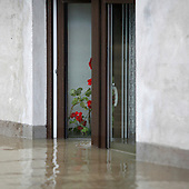 BORKI, POLAND, MAY 24, 2010:.A flooded house window.The latest chapter of disastrous floods in Poland has been opened yesterday, May 23, 2010, after Vistula river broke its banks and flooded over 25 villages causing evacualtion of most inhabitants..Photo by Piotr Malecki / Napo Images..BORKI, POLSKA, 24/05/2010:.Ewakuacja mieszkanca wsi. Najnowszy akt straszliwych tegorocznych powodzi zostal rozpoczety wczoraj gdy Wisla przerwala waly na wysokosci wsi Swiniary kolo Plocka..Fot: Piotr Malecki / Napo Images ..