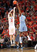 North Carolina Tar Heels guard P.J. Hairston (15) blocks the shot of Virginia Cavaliers guard Paul Jesperson (2) during the game in Charlottesville, Va. North Carolina defeated Virginia 54-51.