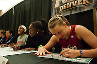 DENVER, CO--Mikaela Ruef signs posters during a fan autograph session at the Pepsi Center for the 2012 NCAA Women's Final Four festivities in Denver, CO.