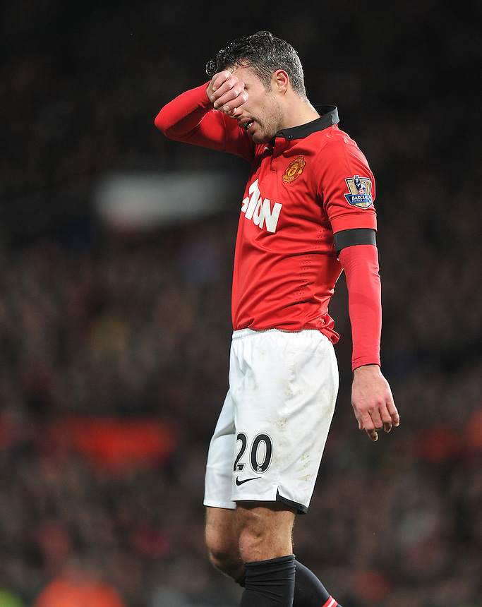 Manchester United's Robin van Persie shows his frustration at his team conceding a last minute equaliser<br /> <br /> Photo by Dave Howarth/CameraSport<br /> <br /> Football - Barclays Premiership - Manchester United v Fulham - Sunday 9th February 2014 - Old Trafford - Manchester<br /> <br /> &copy; CameraSport - 43 Linden Ave. Countesthorpe. Leicester. England. LE8 5PG - Tel: +44 (0) 116 277 4147 - admin@camerasport.com - www.camerasport.com