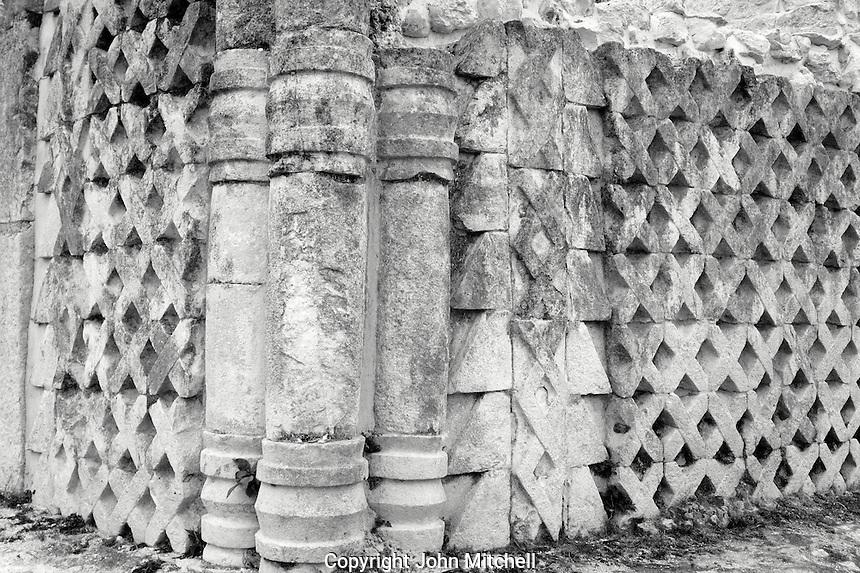 Columns and latticed stone work at the Mayan ruins of  Kabah, Yucatan, Mexico            .