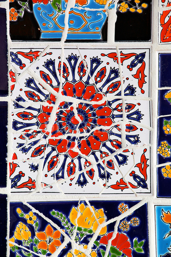 close up of hand decorated tiles