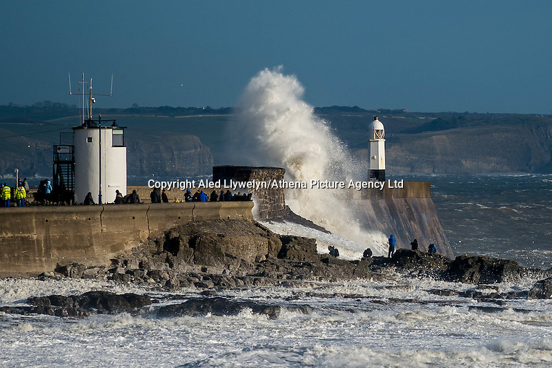 Thursday 23 February 2017<br /> Pictured: Huge waves batter the harbour wall and lighthouse at Porthcawl, Wales, UK<br /> Re: Storm Dorris batters the UK