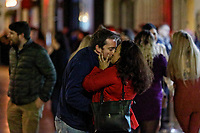 Pictured: A couple kiss each other in Wind Street, Swansea, Wales, UK. Friday 20 December 2019<br /> Re: Black Eye Friday (also known as Black Friday, Mad Friday, Frantic Friday) the last Friday before Christmas, in Swansea, Wales, UK.
