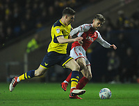 Fleetwood Town's Conor McAleny is fouled by Oxford United's Josh Ruffels<br /> <br /> Photographer Kevin Barnes/CameraSport<br /> <br /> The EFL Sky Bet League One - Oxford United v Fleetwood Town - Tuesday 10th April 2018 - Kassam Stadium - Oxford<br /> <br /> World Copyright &copy; 2018 CameraSport. All rights reserved. 43 Linden Ave. Countesthorpe. Leicester. England. LE8 5PG - Tel: +44 (0) 116 277 4147 - admin@camerasport.com - www.camerasport.com