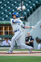 Willy Adames (27) of the Durham Bulls follows through on his swing against the Charlotte Knights at BB&T BallPark on May 15, 2017 in Charlotte, North Carolina. The Knights defeated the Bulls 6-4.  (Brian Westerholt/Four Seam Images)