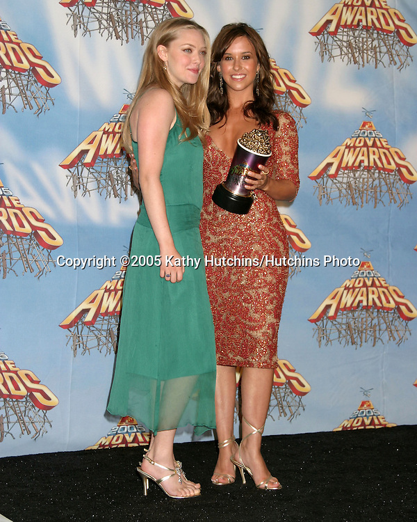 Amanda Seyfried and Lacey Chabert after winning award at the .MTV Movie Awards at the Shrine Auditorium, .Los Angeles, CA.June 4, 2005.©2005 Kathy Hutchins / Hutchins Photo