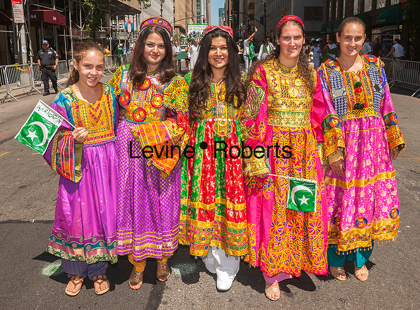 Pakistani-Americans and their supporters march on Madison Avenue in New York on Sunday, August 25, 2013 in the Pakistani Independence Day Parade to celebrate the 67th anniversary of the partition of Pakistan and India  and their independence from the British Empire.  The festivities, which drew crowds from the tri-state area, included a parade which culminated in a street fair with entertainment and an assortment of Pakistani culinary delights. (© Richard B. Levine)