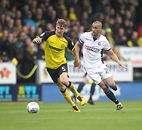 Bolton Wanderers Darren Pratley in action with Burton Albion's Kyle McFadzean<br /> <br /> Photographer Mick Walker/CameraSport<br /> <br /> The EFL Sky Bet Championship - Burton Albion v Bolton Wanderers - Saturday 28th April 2018 - Pirelli Stadium - Burton upon Trent<br /> <br /> World Copyright &copy; 2018 CameraSport. All rights reserved. 43 Linden Ave. Countesthorpe. Leicester. England. LE8 5PG - Tel: +44 (0) 116 277 4147 - admin@camerasport.com - www.camerasport.com