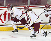 Melissa Bizzari (BC - 4), Alex Carpenter (BC - 5) - The Boston College Eagles defeated the visiting Cornell University Big Red 4-3 (OT) on Sunday, January 11, 2012, at Kelley Rink in Conte Forum in Chestnut Hill, Massachusetts.
