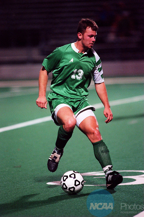 Caption: Bethany College's Michael Rogers moves the ball downfield at the 1994 Division III Men's Soccer Championship November 19, 1994 in Trenton, New Jersey.. Bethany College defeated Johns Hopkins University 1-0 in double overtime. Katherine Wyland/NCAA Photos