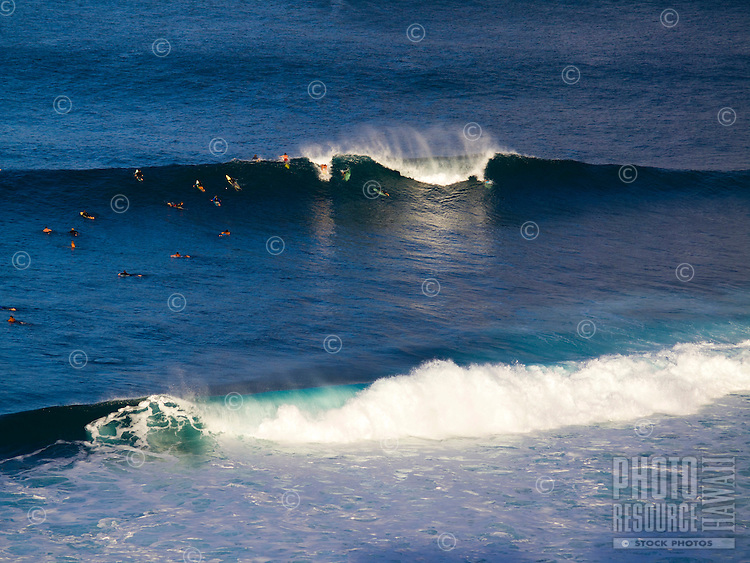 Surfers catch large waves at Honolua Bay, Maui.