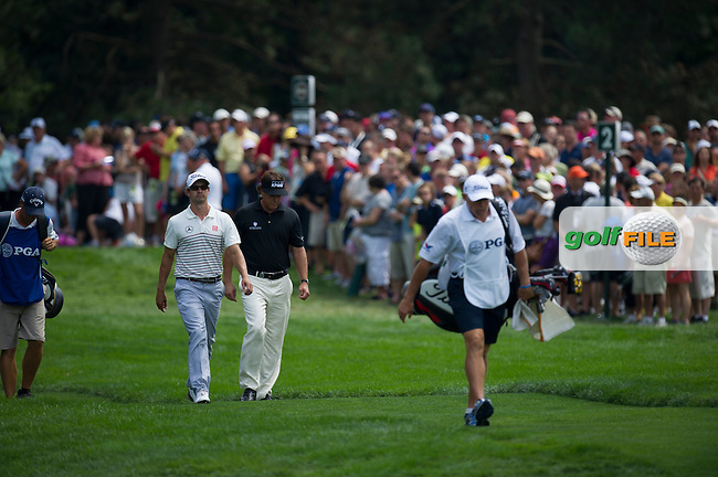 Phil Mickelson and Adam Scott in action during the opening round of the PGA Championship at Oak Hill Country Club (Photo: Anthony Powter) www.golffile.ie
