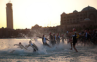 12 MAR 2011 - ABU DHABI, UAE - Elite women competitors dive into the water for the start of the Abu Dhabi International Triathlon .(PHOTO (C) NIGEL FARROW)