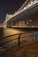 THIS IMAGE IS AVAILABLE EXCLUSIVELY FROM GETTY IMAGES.....Please search for image # 200527593-001..on www.gettyimages.com....Manhattan Bridge, Lower Manhattan and East River, Illuminated at Night, viewed from Brooklyn, New York City, New York State, USA